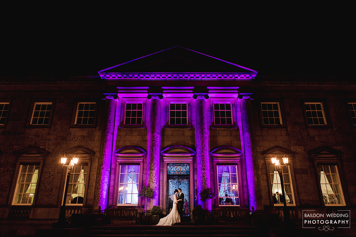 Wedding portrait from Denton Hall Ilkley wedding. Denton Hall is lit with purple lights and bride and groom are lit