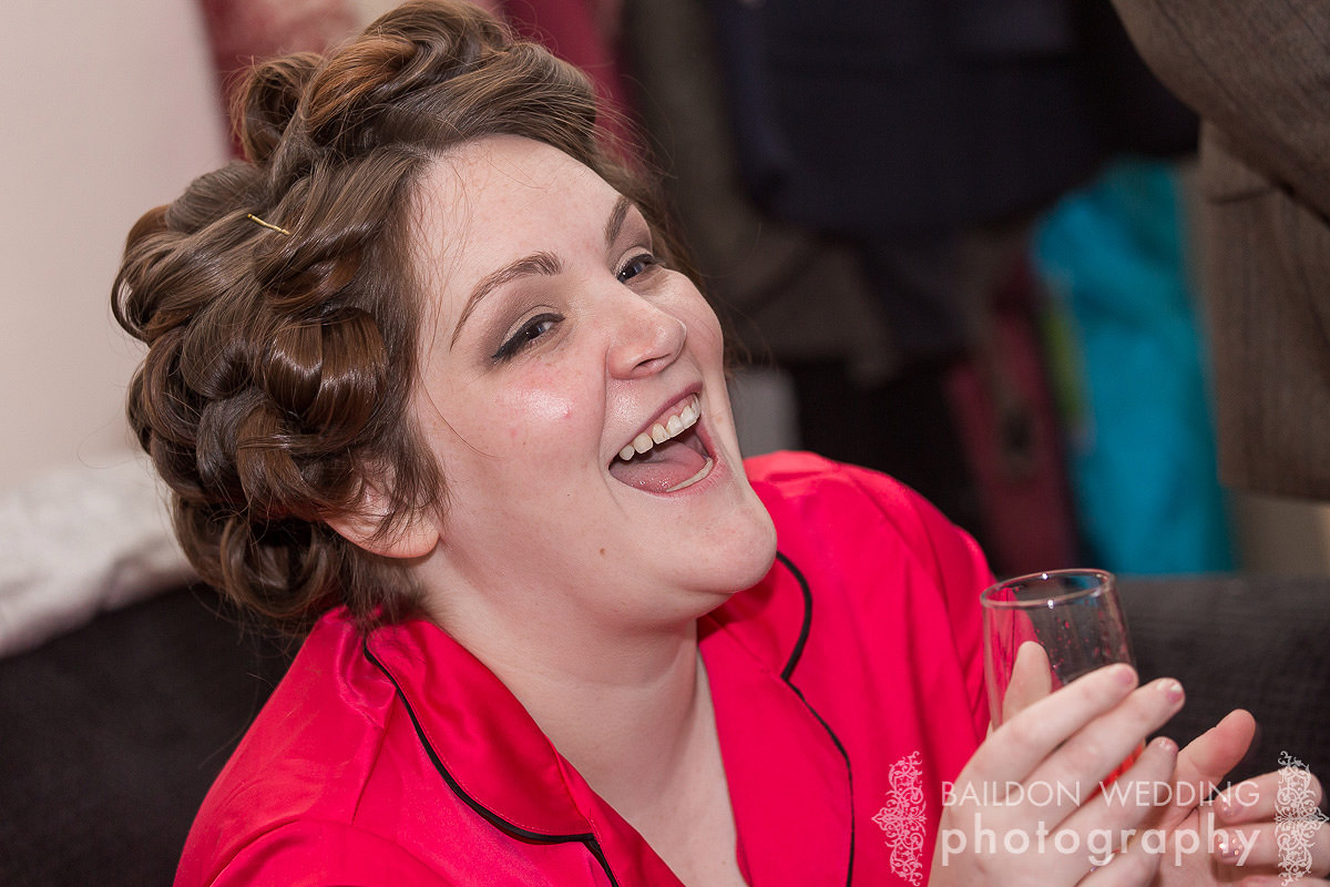 top times bride laughs with champagne