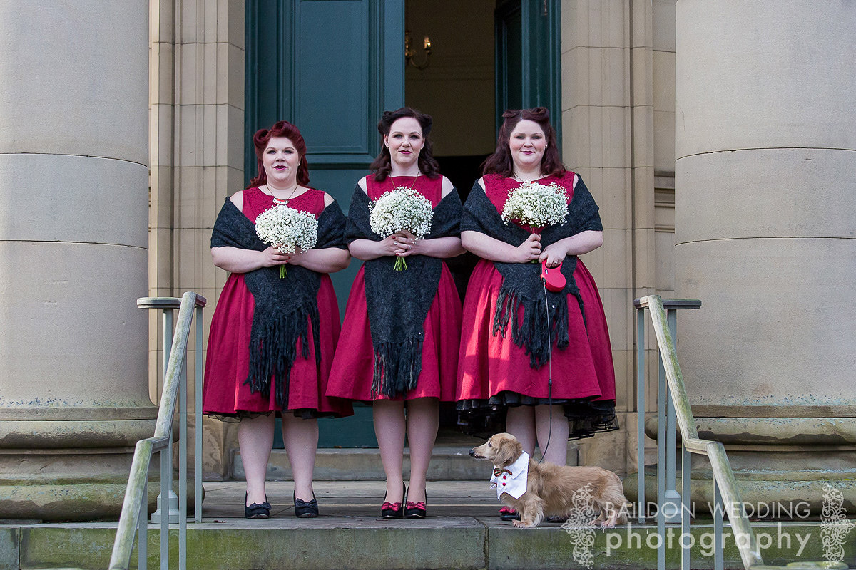 bridesmaids outside Saltaire United reformed church with dog awaiting bride