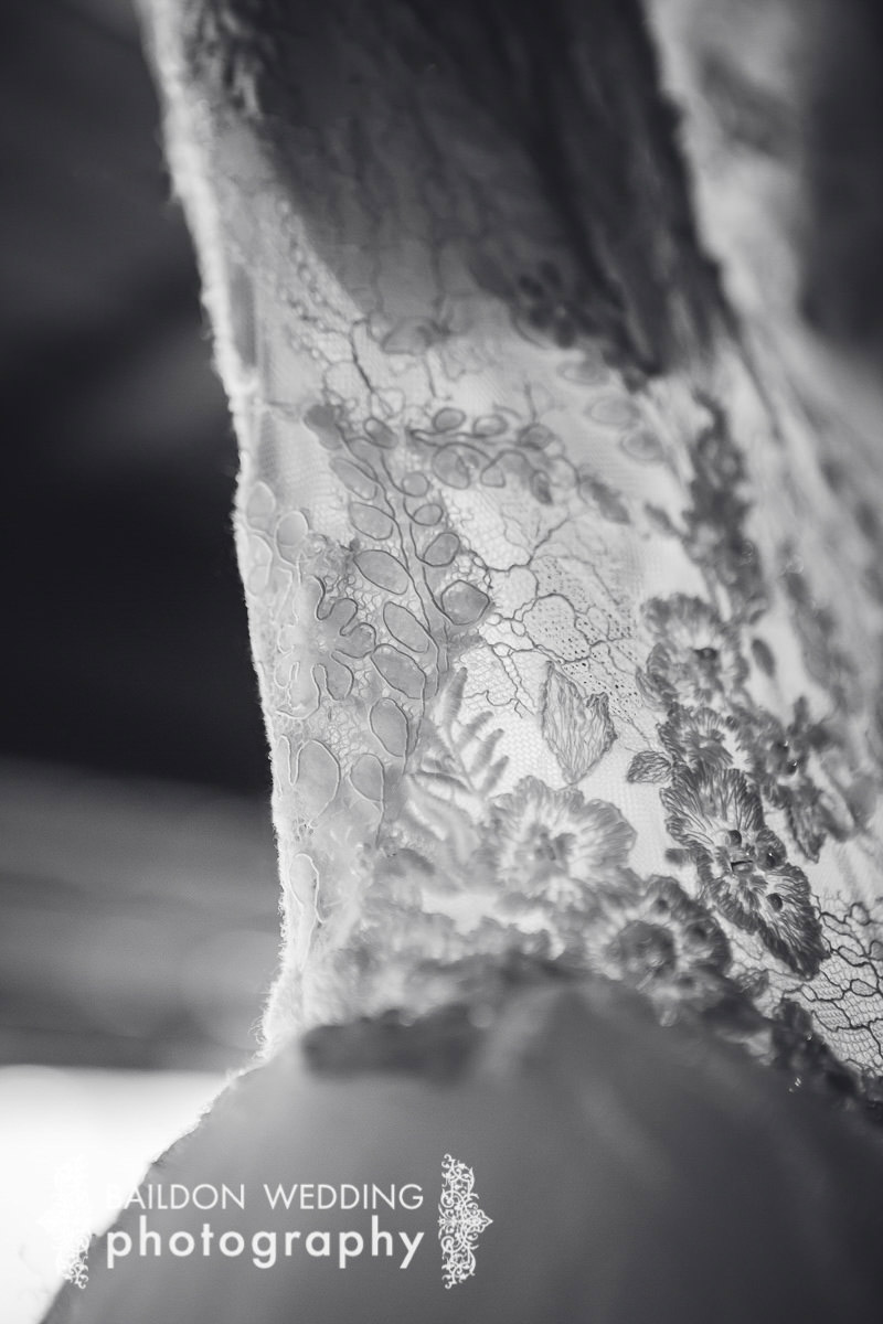 lace wedding dress black and white close up detail