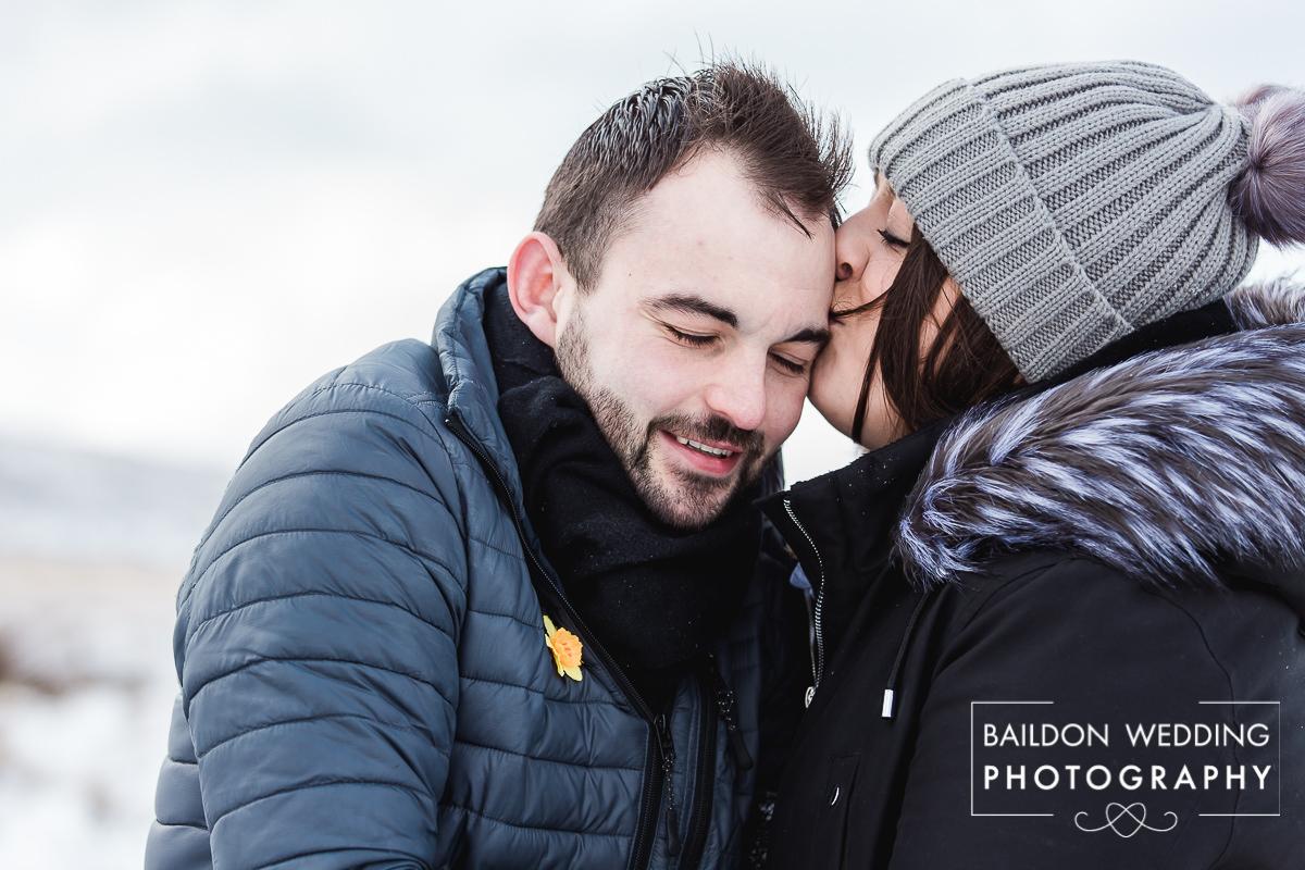Couple kiss cheeks