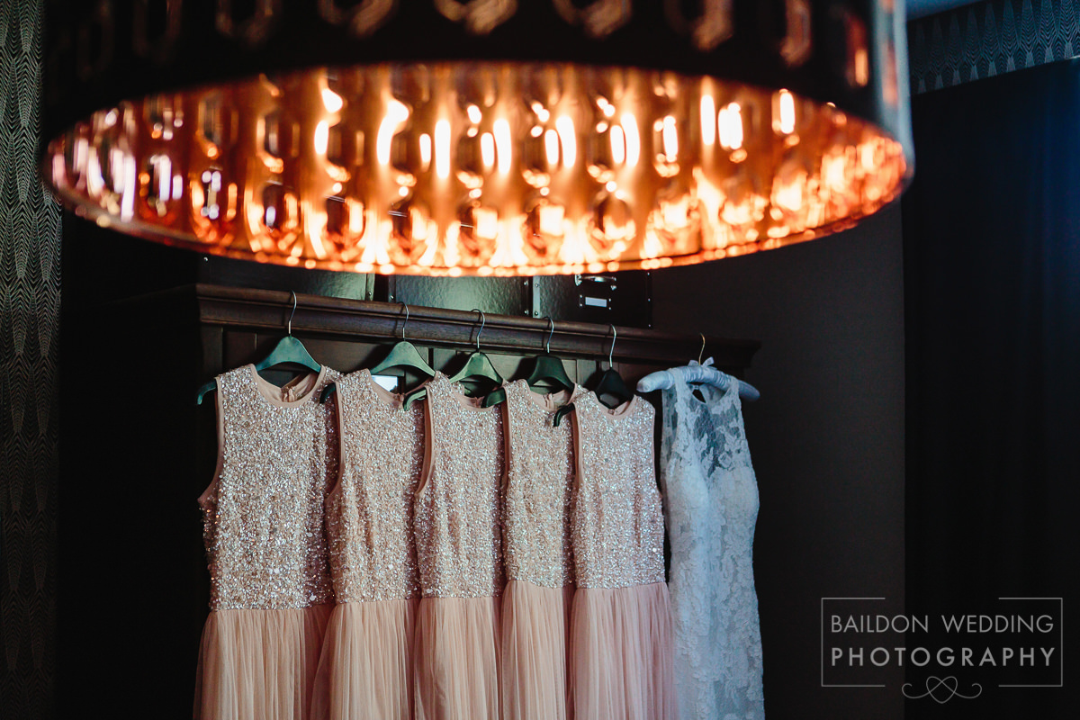 all the dresses hanging on the dark wardrobe
